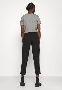 Calvin Klein - MILANO PANTS - Teplákové kalhoty - black - 2