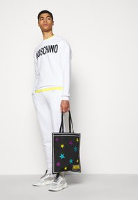 MOSCHINO - TROUSERS - Tracksuit bottoms - white - 3