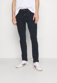 Nudie Jeans - UNISEX - Jeans slim fit - black ocean - 0
