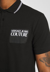 Versace Jeans Couture - PATCH - Polo shirt - black - 5