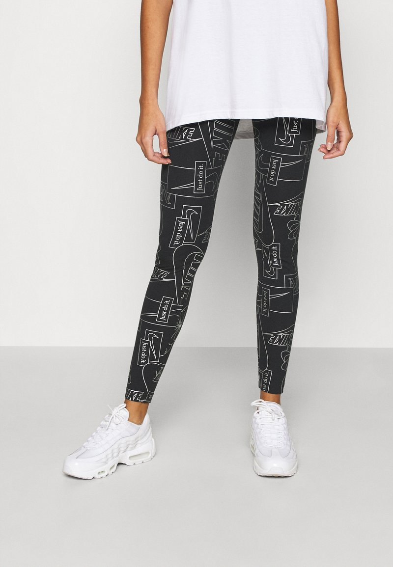 Nike Sportswear - TIGHT - Leggings - Trousers - black