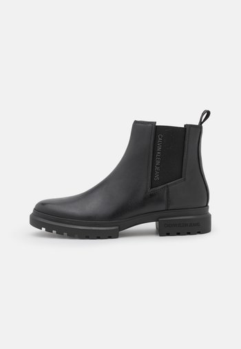 CLEATED MID CHELSEA BOOT - Classic ankle boots - black