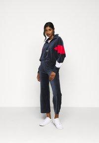 Fila Petite - BIAN CROPPED PANT - Trousers - black iris - 1