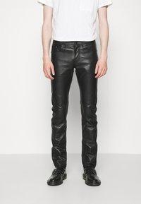 KARL LAGERFELD - PANTS - Spodnie skórzane - black - 0