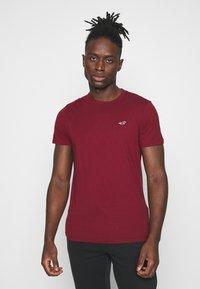 Hollister Co. - CREW 7 PACK - T-shirt basic - white/burg/beige/navy/grey siro/green/black - 3