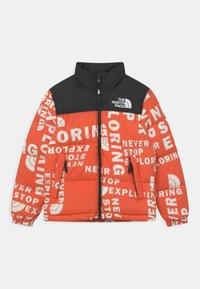 The North Face - PRINTED RETRO NUPTSE UNISEX - Down jacket - red orange - 0