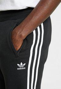 adidas Originals - STRIPES PANT UNISEX - Pantalon de survêtement - black - 3