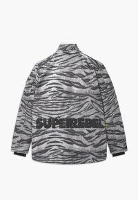 SuperRebel - TECHNICAL UNISEX - Snowboardová bunda - off-white/black - 2