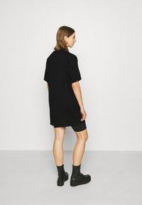 Fila - SATINKA TEE DRESS - Jersey dress - black - 2