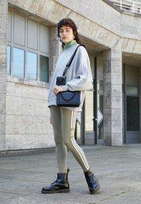 adidas Originals - TREFOIL ORIGINALS ADICOLOR LEGGINGS COMPRESSION - Leggings - Trousers - orbit green - 1