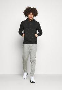 Calvin Klein Golf - ALL OVER PRINT HOODIE - Sweatshirt - black - 1