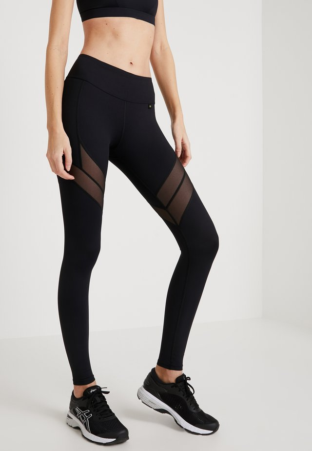 INDA - Leggings - Trousers - black