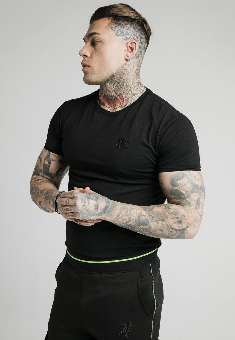 Illusive London Juniors - T-paita - black