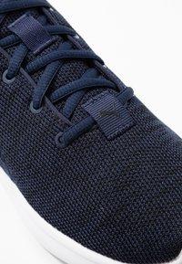 Puma - SOFTRIDE VITAL CLEAN - Zapatillas de running neutras - peacoat/black/white - 5