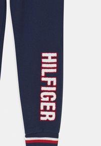 Tommy Hilfiger - TRACK UNISEX - Pyjama bottoms - blue - 2