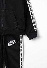 Nike Sportswear - NIKE BLOCK TAPING TRICOT SET - Tracksuit - black - 8