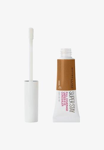 SUPER STAY UNDER-EYE CONCEALER - Concealer - 40 caramel
