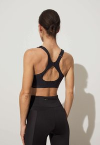 OYSHO - High support sports bra - black - 4