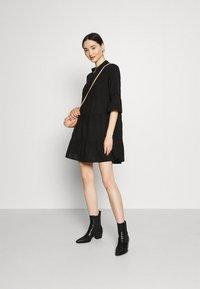 Vero Moda - VMHELI 3/4  WVN GA COLOR - Day dress - black - 1