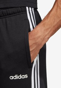 adidas Performance - ESSENTIALS 3STRIPES FRENCH TERRY SPORT PANTS - Tracksuit bottoms - black - 4
