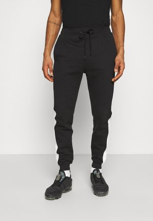 CUT & SEW SIDE UNISEX - Tracksuit bottoms - black