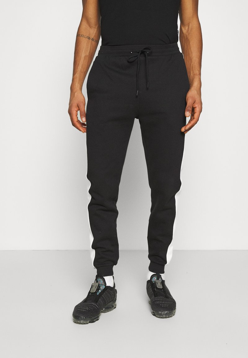 Urban Threads - CUT & SEW SIDE UNISEX - Pantaloni sportivi - black