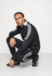 adidas Performance - TIRO - Träningsbyxor - black - 3