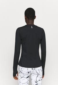 Under Armour - EMPOWERED LONG SHIRT CREW - Long sleeved top - black - 2