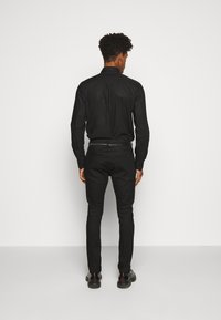 HUGO - Slim fit jeans - black - 2