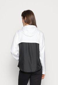 Nike Sportswear - Training jacket - white/black - 2