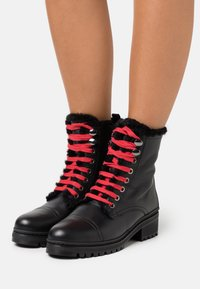 Unisa - IRACHE - Lace-up ankle boots - black - 0