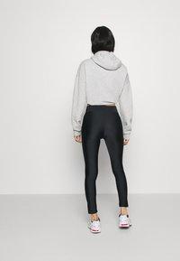 Monki - FRIDA SHINY - Leggings - Trousers - black dark - 2