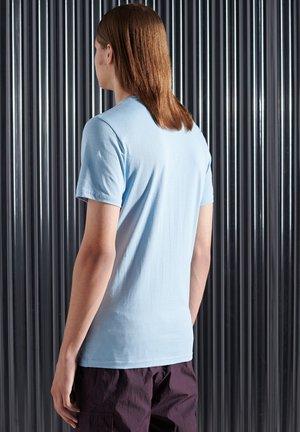 T-shirt med print - brea blue