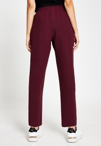 River Island - Tracksuit bottoms - red - 2