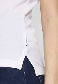 Calvin Klein - ESSENTIAL - Polo shirt - calvin white - 6