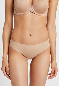 DKNY Intimates - LITEWEAR CUT ANYWHERE THONG - Shapewear - beige - 0