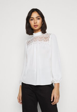 RUFFLE NECK YOKE - Button-down blouse - ivory