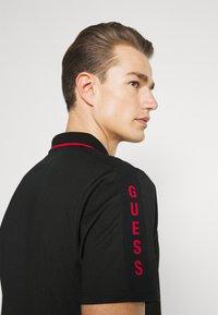 Guess - TAPE - Polo shirt - jet black - 3