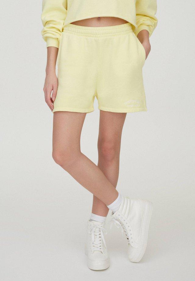 Spodnie treningowe - yellow