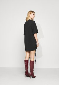 Milk it - DRESS WITH LACE UP SIDES & SNAKESCREEN - Day dress - black - 2