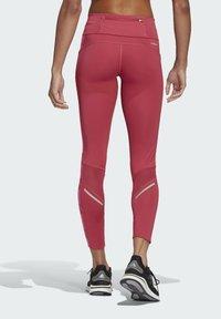 adidas Performance - OWN THE RUN CELEBRATION RUNNING LANGE TIGHT. - Leggings - pink - 2