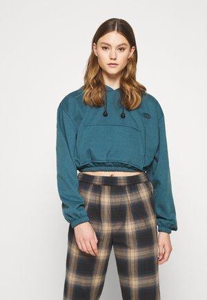 INTERNATIONAL SLOGAN HOODIE - Sweatshirt - teal