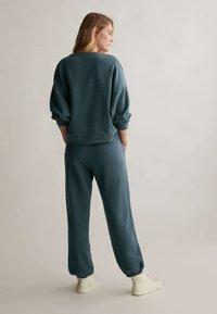 OYSHO - Pantalon de survêtement - dark blue - 2