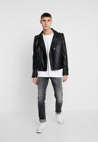 Diesel - TEPPHAR-X - Slim fit jeans - black denim - 1
