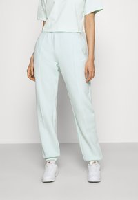 Nike Sportswear - PANT TREND - Tracksuit bottoms - barely green/white - 0