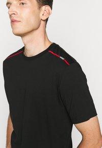 HUGO - DYRTID - T-shirts print - black - 5