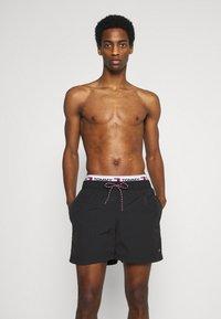 Tommy Hilfiger - LOGOLINE MEDIUM DRAWSTRING - Swimming shorts - black - 0