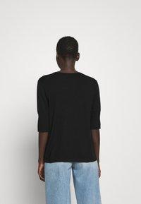 Filippa K - CLAIRE ELBOW SLEEVE - Basic T-shirt - black - 2