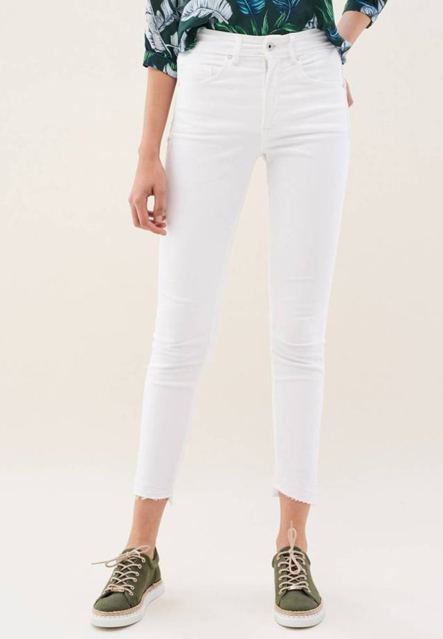 PUSH IN - Slim fit jeans - white