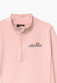 Ellesse - RUNIO ZIP UNISEX - Funkční triko - light pink - 2